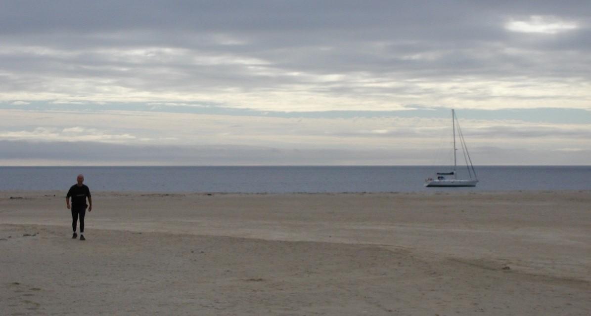 MIngulay bay yacht at anchor in bay