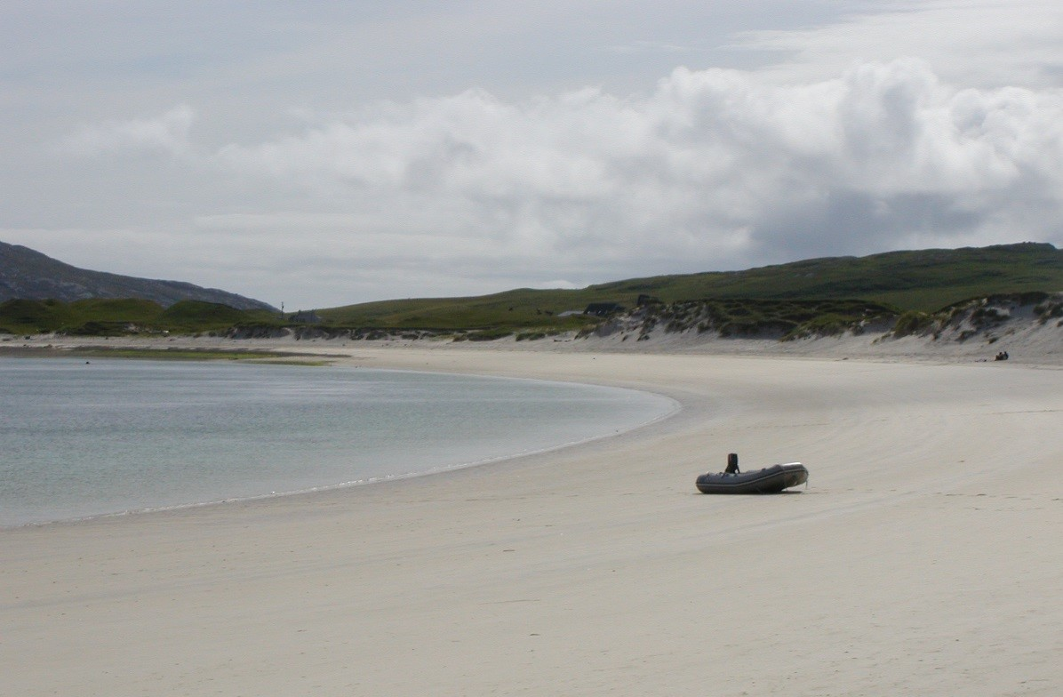 Dinghy on sandy beach Bagh Bay vatersay