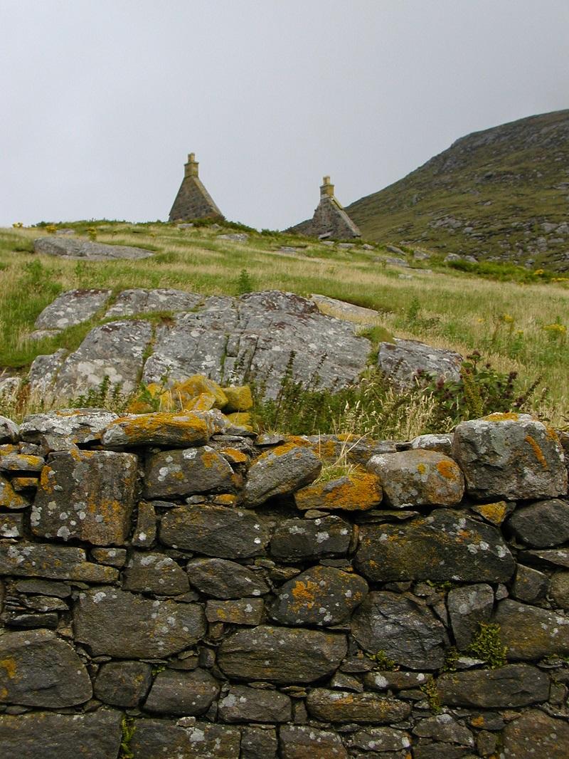 Mingulay ruins and stone wall scottish island