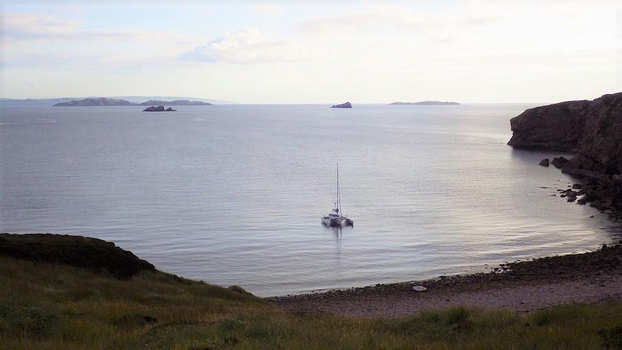Yacht anchored in bay scottish west coast