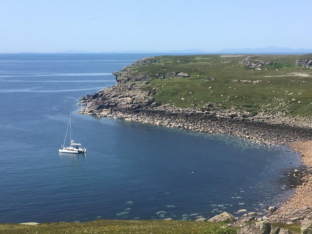 Yacht at anchor in bay Scotland Longa island