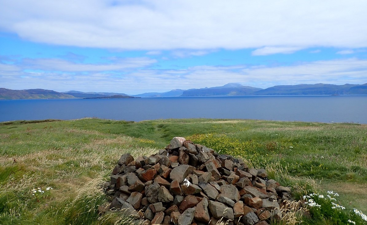 Cairn on Staffa island Scotland looking to Mull