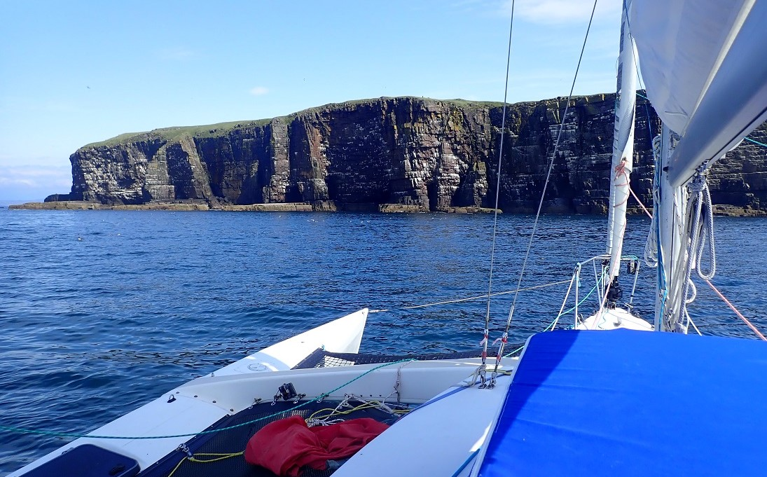 Handa island cliffs from a yacht