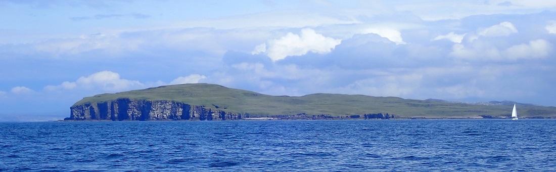 Handa island Scotland from a yacht