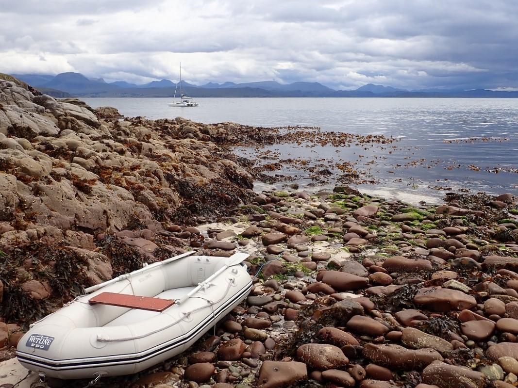 dinghy landed on beach Summer isles