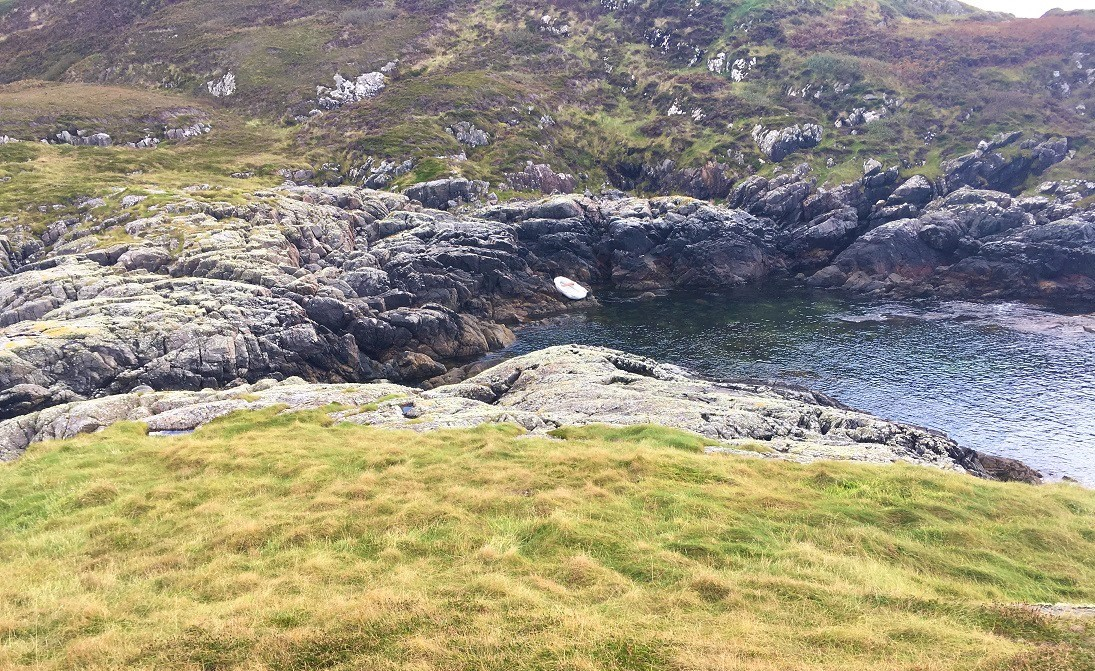 Dinghy on beach scottish island soyea Lochinver